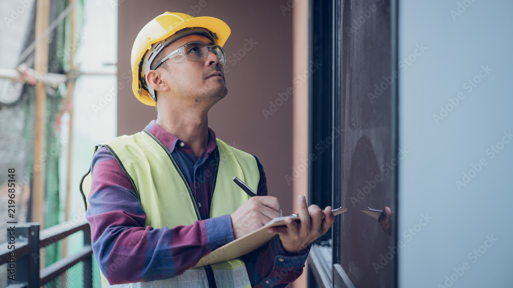 Fototapeta Construction concept , Foreman officer inspector defect about engineer&architect work home building before complete project