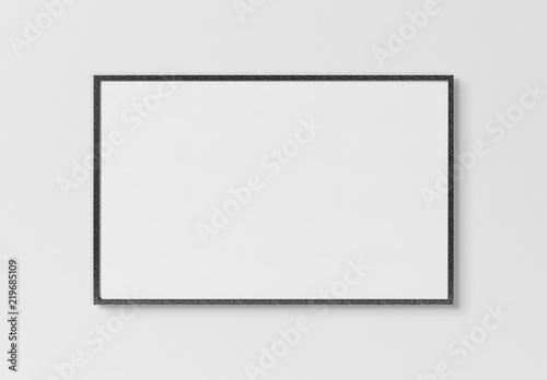 Black rectangular horizontal frame hanging on a white wall mockup 3D rendering