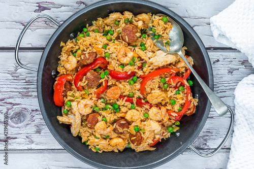 Spanish paella with prawns, chicken, chorizo and red pepper - top view