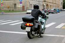 Rider On A Road In Front Of A Pedestrian Crossing
