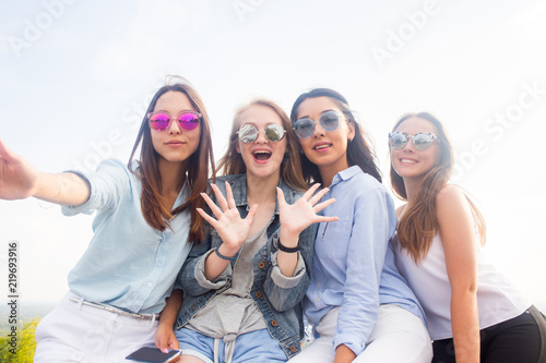 Best Friends Take Selfies While Walking In The Park Four Women Wearing Sunglasses Are Having A Good Day Buy This Stock Photo And Explore Similar Images At Adobe Stock Adobe Stock