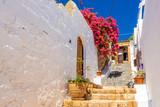 Fototapeta Fototapety na drzwi - Beautiful Greek street with summer flowers in Lindos village. Rhodes island. Greece.
