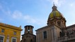 View on historic architecture of the city centre as clouds move slowly on blue sky on a sunny day in Palermo in Italy.
