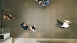 canvas print picture - Defocused business people in a lobby