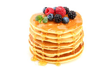 Pancakes Stack With Different Berries And Honey Isolated On White Background