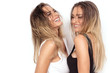 canvas print picture - Sensual twins women posing on white background.