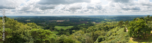 Foto op Canvas Olijf Panoramic view of the Surrey and Sussex countryside from the North Downs to the South Downs in England, UK. Taken from the top of Leith Hill Tower on a cloudy summer's day.