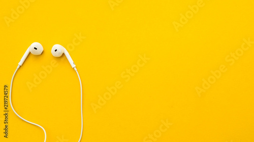 Earphone on a yellow background Canvas Print