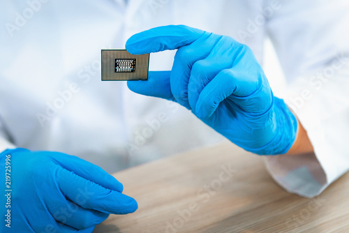 Close up portrait of engineer hand is holding CPU's computer