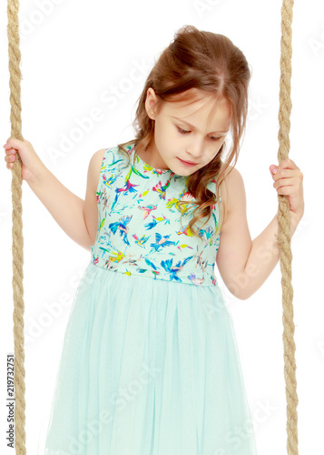 Garden Poster Fairytale World Little girl swinging on a swing