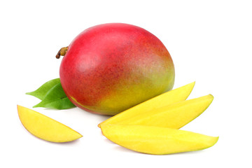 mango slice with green leaves isolated on white background. healthy food.