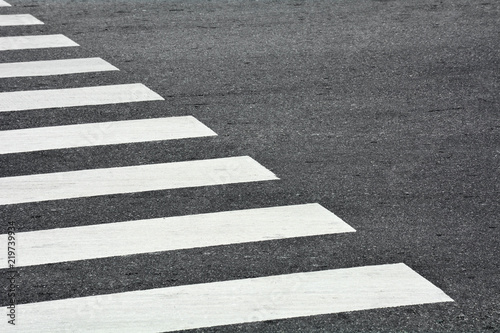 Fotografering Zebra crosswalk on a asphalt road - closeup background