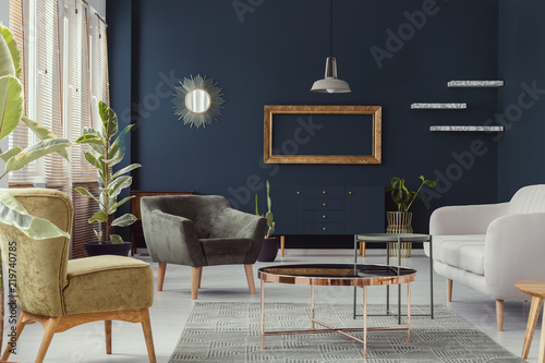 Mockup of gold frame in navy blue living room interior with ...