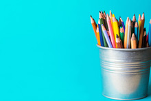 Bucket With Pencils On A Blue ...