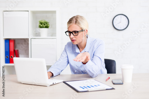 Fotografie, Obraz  stressed business woman sitting in office having problems with computer