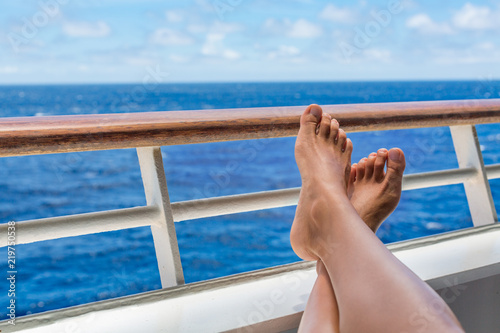5a9a508ec5a Cruise vacation travel woman relaxing with feet on balcony ship deck  enjoying ocean view of holiday