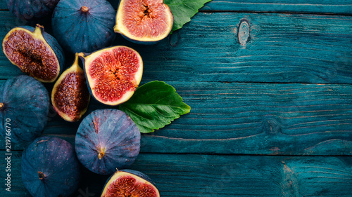 Fig. Fresh fruit figs on a blue wooden table. Free space for text. Top view.