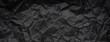 Leinwandbild Motiv Ragged crumpled dark black paper texture background