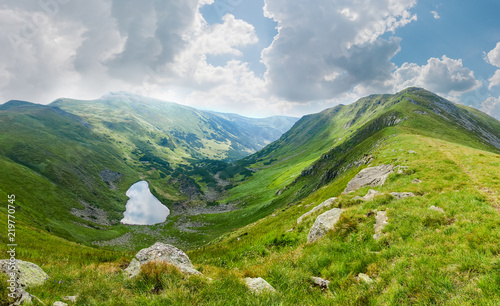 Highland valley with mountain lake in the Carpathian Mountains