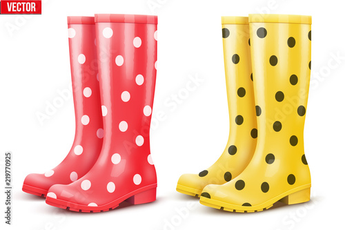 Fototapeta Set of rubber rain boots. Fashion Symbol of garden wok or autumn and bad weather. Read and yellow color with dots. Vector illustration Isolated on white background. obraz
