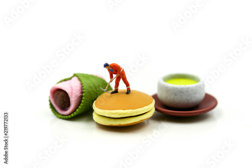 Fotobehang Dessert Miniature people : man worker with dessert,education and food concept.
