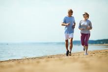 Active Senior Man And Woman Ru...