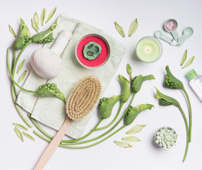 Panel Szklany Do Spa Spa setting with accessories and natural products for cellulite treatment at home on white background. Wellness setting flat lay with tropical leaves and flowers. Massage tools. Body care concept