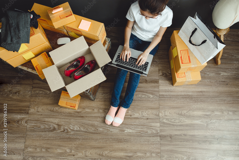 Fototapeta Asian teenager owner business woman work at home for online shopping and sale..
