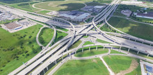 Panorama Vertical Aerial Interstate 10 Or Katy Freeway Massive Intersection, Stack Interchange, Elevated Road Junction Overpass Cloud Blue Sky. Top View Metropolitan Area Of Katy, Texas, USA