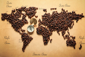 Panel Szklany Kawa World map made of roasted coffee beans with compass, top view