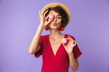 Joyful Brunette Woman In Dress And Straw Hat Having Fun