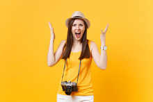 Shocked Tourist Woman In Summer Casual Clothes, Hat With Retro Vintage Photo Camera Isolated On Yellow Orange Background. Girl Traveling Abroad Travel On Weekends Getaway. Air Flight Journey Concept.