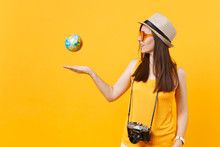 Traveler Tourist Woman In Summer Casual Clothes, Hat Toss Up Globe Isolated On Yellow Orange Background. Female Passenger Traveling Abroad To Travel On Weekends Getaway. Air Flight Journey Concept.