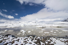 Dramatic Wide View Of Clouds Moving Over Fjallsárlón Glacier Lagoon Full Of Icebergs Covered In Snow, Iceland