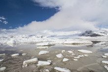 Dramatic View Of Clouds Moving Over Fjallsárlón Glacier Lagoon Full Of Icebergs Covered In Snow, Iceland