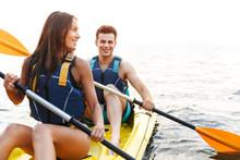 Cheerful Young Couple Kayaking