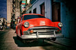 old american car of the 50s parked for repairs on a street in Havana
