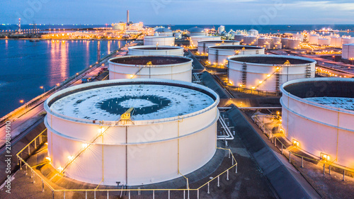 Fotografía Aerial view oil terminal building with boat background is industrial facility for storage of oil and petrochemical products ready for transport to further business storage