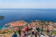 Leinwanddruck Bild Tourist portrait in Dubrovnik city in summer, Croatia