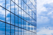 canvas print picture - Clouds are reflected in a glass facade