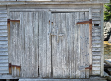 Grunge Double Door On The Side Of A Boat Shed In Newfoundland, Canada