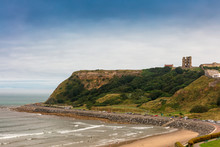 North Bay Beach In Scarborough With Medieval Castle In The Background.
