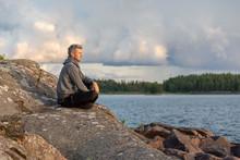 Man Sitting By The Lake