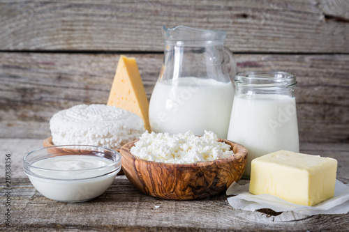 Poster Dairy products Selection of dairy products on rustic wood background