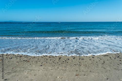 Staande foto Strand sea water foam on the beach