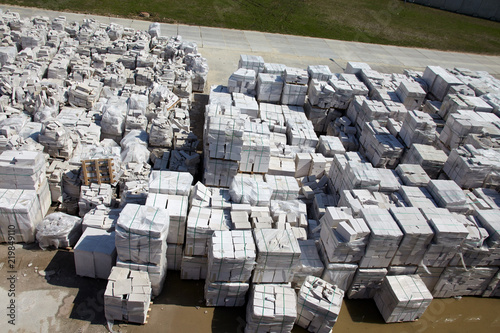 Valokuva  Aerial view of autoclaved aerated concrete blocks, both defective and good, on p