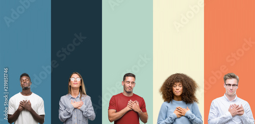 Group of people over vintage colors background smiling with hands on chest with closed eyes and grateful gesture on face Poster Mural XXL