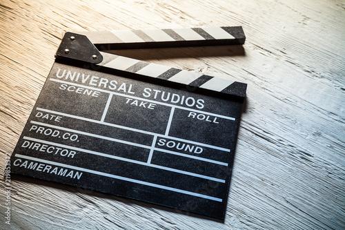 Vintage film clapper on wooden desk