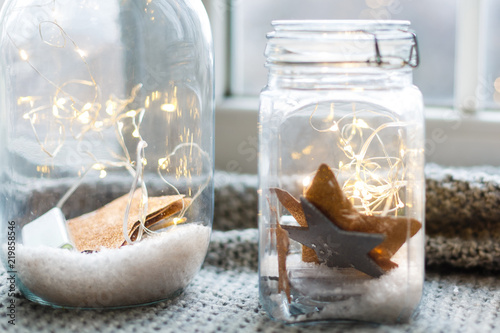 Warm light LED and a jar with dark background Tableau sur Toile