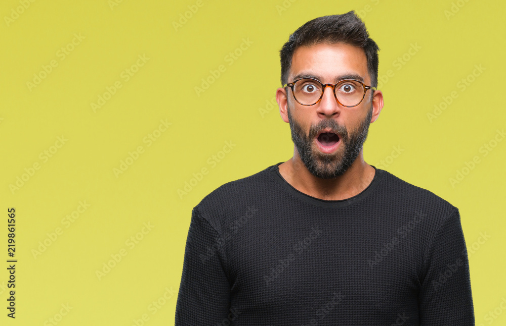 Fototapety, obrazy: Adult hispanic man wearing glasses over isolated background afraid and shocked with surprise expression, fear and excited face.